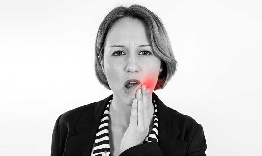 woman suffering from toothpain